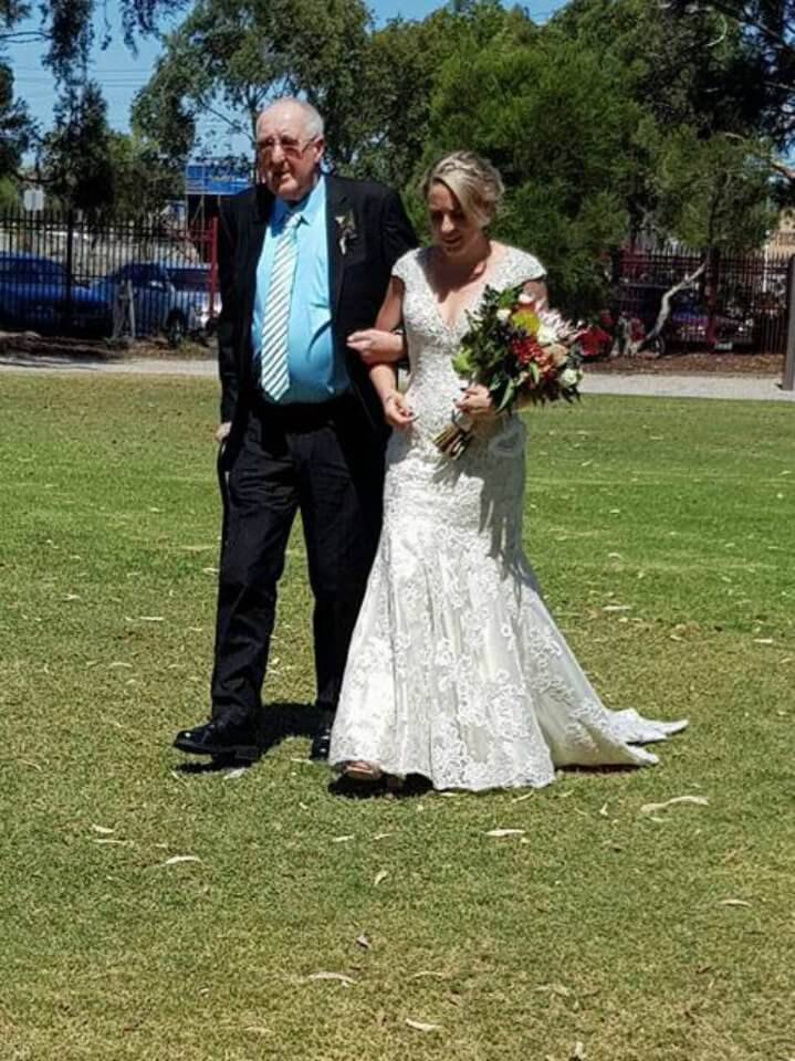Sick dad walks daughter down the aisle after she received a generous wedding dress gift