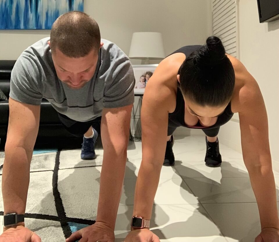 Jeff-and-Melissa-Timmer-doing-plank
